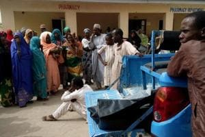 A man reacts as dead bodies are brought to a hospital after a suspected Boko Haram attack on the edge of Maiduguri
