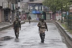 Paramilitary soldiers patrol during restrictions in downtown area of Srinagar on April 3.