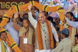 BJP president Amit Shah being garlanded during a public meeting in Bhawanipatna on Wednesday.
