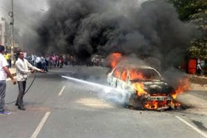 A Tata indigo car caught fire near the Old Delhi Road in Sector-14 on Tuesday.