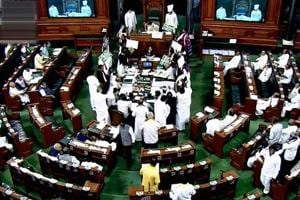 Opposition members protest during the ongoing budget session of Parliament in Lok Sabha in New Delhi on Wednesday.