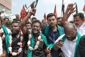 DMK members raise slogans during a protest against central government over delay in setting up Cauvery Management Board to resolve the water-sharing  issue, in Coimbatore on Wednesday.