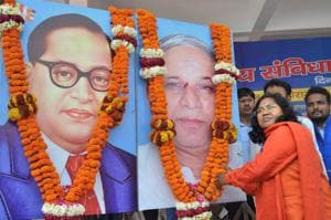 BJP MP Savitri Bai Phule offering tributes to dalit icons Bhimrao Ambedkar and Kansiram during a rally in Lucknow.