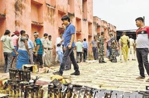 Administration destroys seized liquor in Patna. Police conducted a raid every two minutes and seven people were arrested every hour, according to Bihar government data.