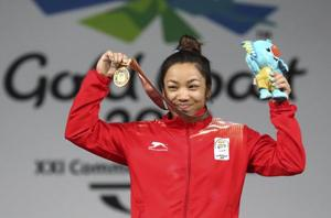 Mirabai Chanu celebrates with her gold medal at the women