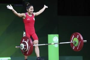 Mirabai Chanu celebrates after making a new Commonwealth Games record in snatch in women