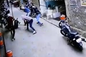 A video grab showing men with masked faces beating up victim Sunil Kumar in Jind on Thursday.