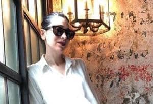 Karisma Kapoor in a white and maroon dress aces casual chic style. See...