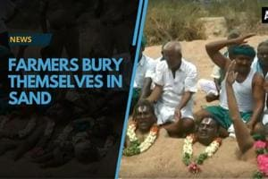 Farmers in Trichy, Tamil Nadu, on Friday, partially buried themselves...