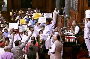 Opposition members protest in the well of the Rajya Sabha on Thursday.