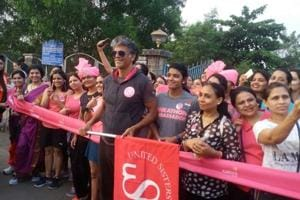 Model-actor Milind Soman with runners at the Pinkathon in Kharghar on Saturday morning.