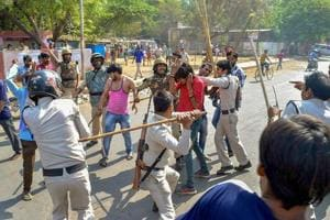 Police personnel lathi charge a protestor during Bharat Bandh, in Gwalior on April 2.