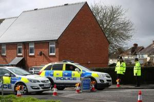 Police officers guard the cordoned off area around the home of former Russian intelligence officer Sergei Skripal in Salisbury, Britain.