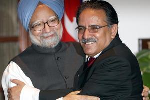 Manmohan Singh hugs Pushpa Kamal Dahal