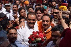 Outgoing Punjab BJPchief Vijay Sampla greets new president Shwait Malik in Chandigarh on Sunday.