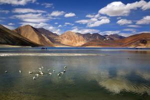 China deploys new patrol boat on lake bordering India