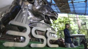 The Bombay Stock Exchange (BSE) logo is displayed in front of a bronze bull statue at the Bombay Stock Exchange in Mumbai, India.