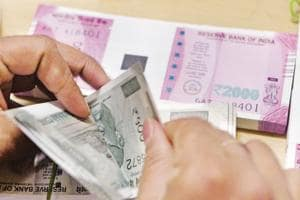 Rupee gains 12 paise against US dollar
