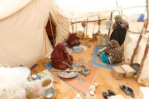 Libyan women displaced due to conflict at an UNHCR camp.
