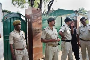 Security personnel stand outside Rashtriya Janata Dal senior leader Rabri Devi