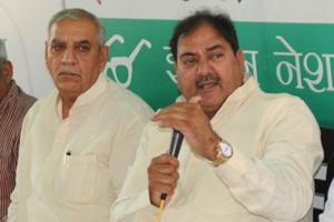 Leader of Opposition in Haryana assembly Abhay Chautala (right) addressing a press conference in Chandigarh on Tuesday as Haryana INLD chief Ashok Arora looks on.