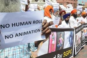 Members of Sikh community hold placards during a protest against the screening of the film