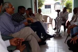 MCGchief medical officer Dr Asrudin speaks with villagers living near the Bandhwari waste treatment. The visit comes a day before the chief minister is due to visit the site. Villagers have planned a protest to draw CM's attention to the health problems they are facing.