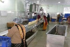Women working in a vinegar unit at Talwara in Hoshiarpur district. Here, vinegar is derived from sugarcane, grapes and amla syrup and not from petrochemicals.