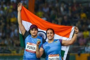 Silver medalist Seema Punia and bronze medalist Navjeet Dhillon of India celebrate their win in the women