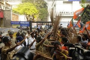 BJP supporters protest in Kolkata on Tuesday against the withdrawal of the EC's order to extend date of filing the nomination for panchayat polls.