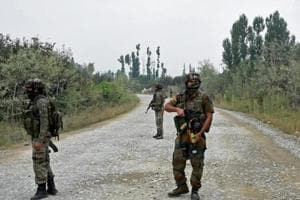 Army personnel stand guard during a gun battle with militants in Pulwama. The area has been cordoned off.