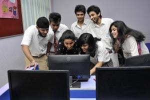 Students check their Central Board of secondary Education (CBSE) board exam results, in Noida.