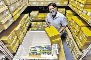 Balkrishna Mandavkar operates out of the hole in the ceiling – gatekeeper to the 20,000 pairs of sandals, sneakers and stilettos in the stockroom loft of Shoe Bazar's Grant Road store.