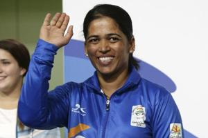 Tejaswini Sawant of India waves after winning the silver medal during the women