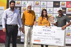 (From left) Honey Baisoya receives the trophy and cheque from Nidhi Srivastava, vice-president, sales & CRM, Kolte - Patil Developers Ltd; Narotam Chowdhary, captain, Poona Club Golf Course and Uttam Singh Mundy, CEO, Professional Golf Tour of India.