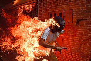 Gas mask on fire, hands waving in the air:Story behind the...