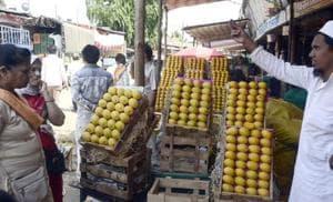 People purchasing mangoes at Market Yard.