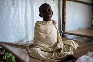 Photos: Fleeing violence in Congo, refugees face cholera in Uganda...