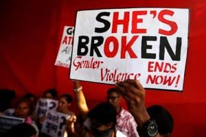 People shout slogans and hold placards during a protest against the rape of an eight-year-old girl, in Kathua, near Jammu and a teenager in Unnao, Uttar Pradesh.