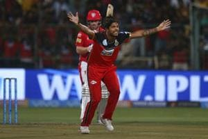 Umesh Yadav, front, appeals successfully for the wicket of Aaron Finch during the 2018 Indian Premier League Twenty20 match between RoyalChallengers Bangalore and Kings XI Punjab at the M Chinnaswamy Stadium on Friday.