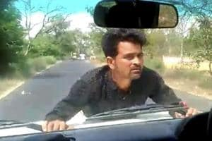 Video: UP official drives vehicle for 4 km as man clings on to car's...