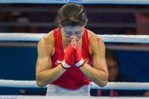 MC Mary Kom bows to the crowd after winning gold in the women