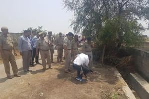 Police at the encounter site in Noida on Saturday.