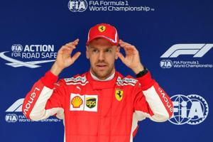 Formula one: Sebastian Vettel snatches pole position in Ferrari...