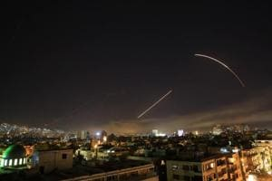Missiles streak across the Damascus skyline as the US launches an attack on Syria targeting different parts of the capital.