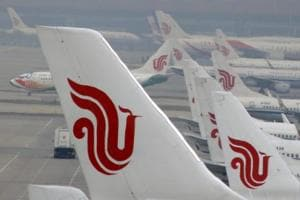 Air China flight diverted after man holds attendant hostage using...