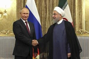 Putin calls Rouhani, predicts global 'chaos' if West hits Syria again
