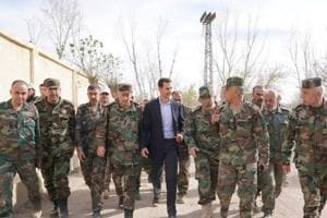 Assad says strikes make Syria even more determined to 'fight...