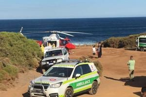 Surfer mauled by shark in Australia swims to shore despite leg...