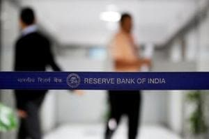 People walk past a barricade inside the Reserve Bank of India (RBI) headquarters in Mumbai.